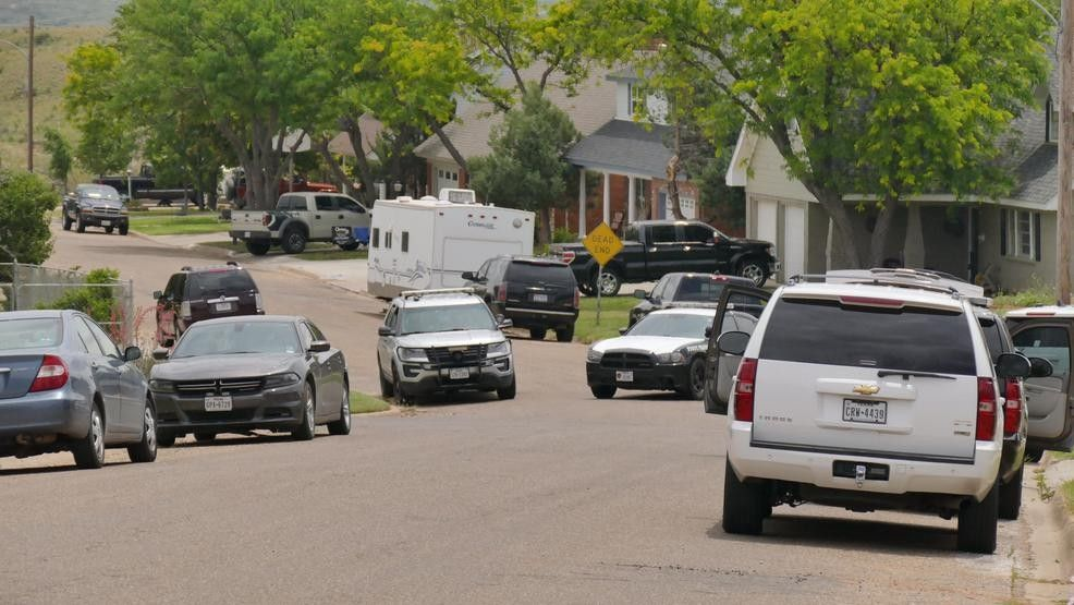 Police cars outside a home